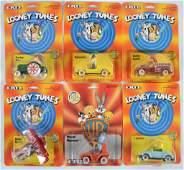 Group of 6 ERTL Looney Toons DieCast Vehicles in