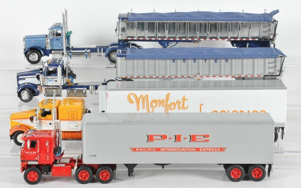 Group of 4 DCP Die-Cast Semi Trucks with Trailers