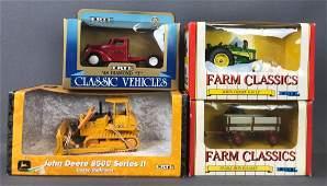 Group of 4 Ertl DieCast Vehicles in Original Packaging
