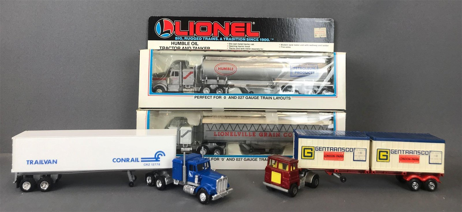 Group of 4 Lionel die-cast Tractor Trailers