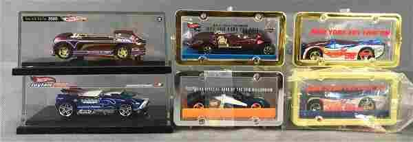Group of 6 Hot Wheels Die-Cast Vehicles in Display