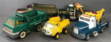 Group of 5 die-cast metal and plastic tow trucks and