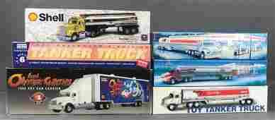 Group of 6 toy trucks in original packaging