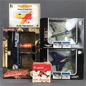 Group of 5 toy airplanes in original packaging