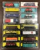 Group of 16 N scale model train cars in original