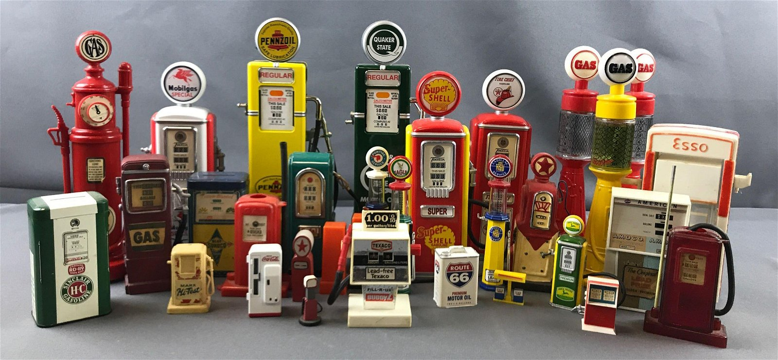 Group of vintage gas pumps and more