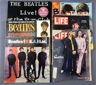 Group of vintage Beatles albums and magazines