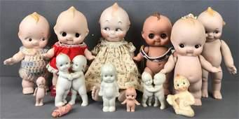 Group of 13 porcelain Kewpie dolls and figurines