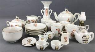22 piece group of Kewpie Toy China tea set pieces