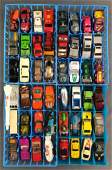 Group of 52 Pieces Assorted Die-Cast Vehicles and trays