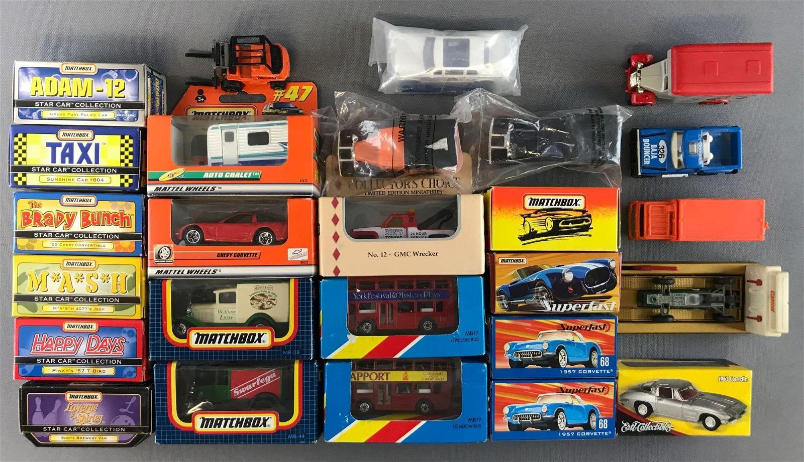 Group of 27 Assorted Die-Cast Vehicles and More