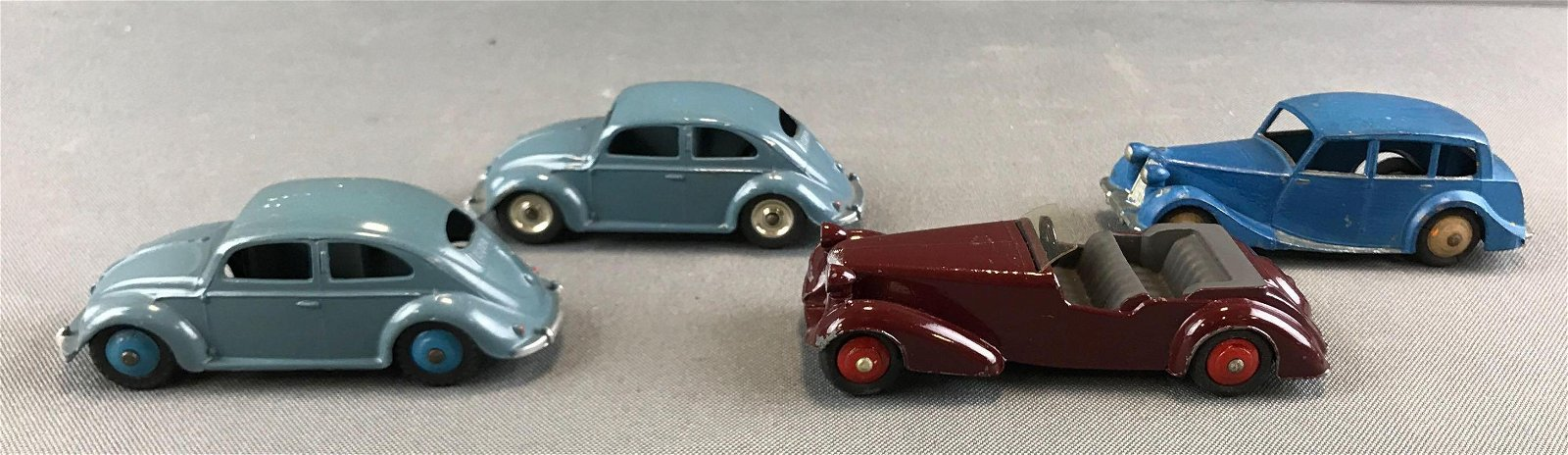 Group of 4 die cast Dinky Toys vehicles