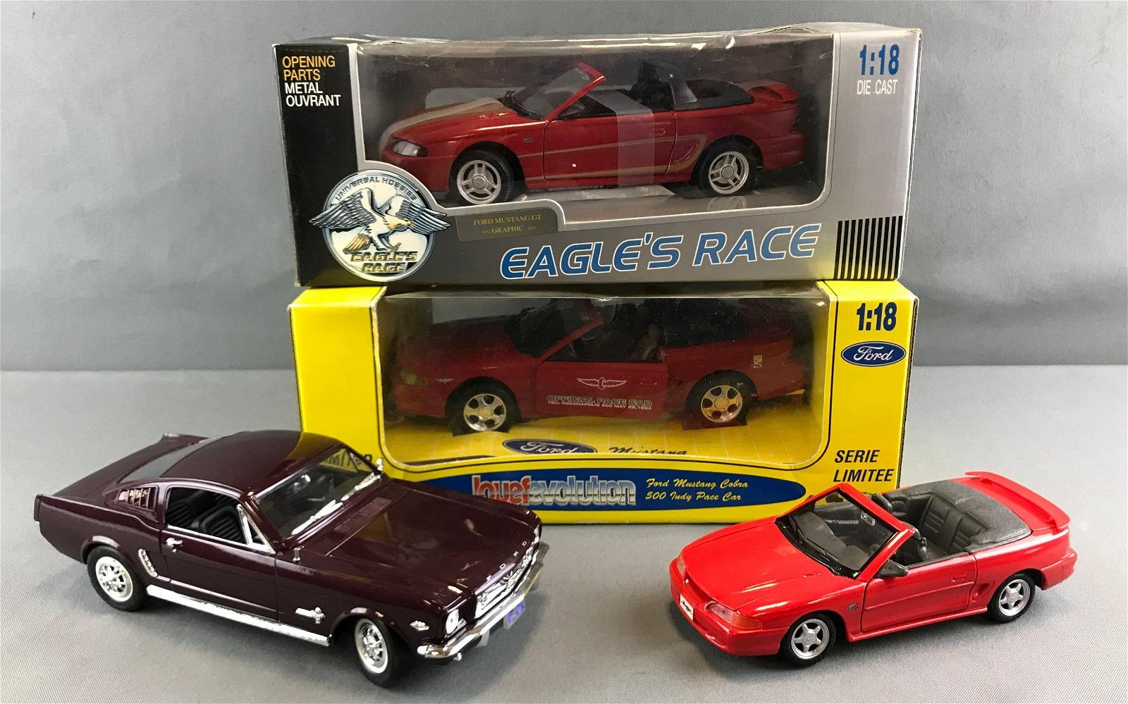 Group of 4 die cast scale model Mustangs