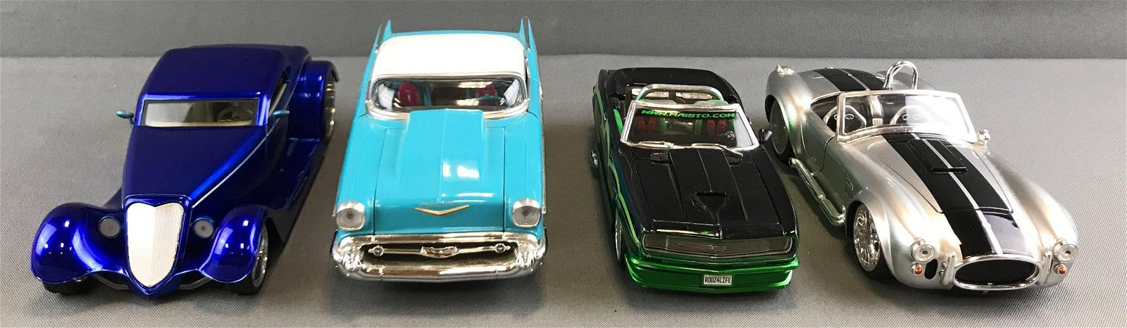 Group of 4 die cast scale model vehicles