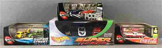 Group of 4 Hot Wheels die-cast vehicle sets in original