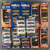 Group of 12 assorted die-cast vehicle sets in original