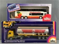 Group of 2 Siku diecast vehicles in original packaging