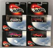 Group of 4 100 Hot Wheels diecast vehicles in