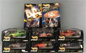 Group of 8 Hot Wheels Pro Racing die-cast vehicles in