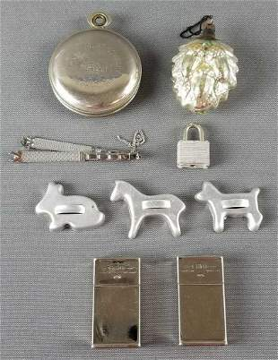Group of vintage match holders, pocket bank, and more