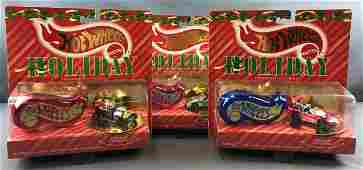 Group of 3 Hot Wheels Holiday Series die cast cars in