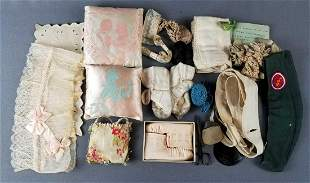 Group of vintage baby booties, girl scout and sewing