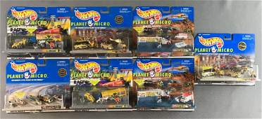 Group of Hot Wheels Planet Micro die-cast vehicles