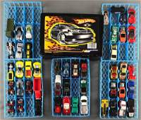 Group of Hot Wheels carrying case and cars