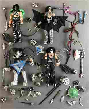 Group of KISS action figures and accessories