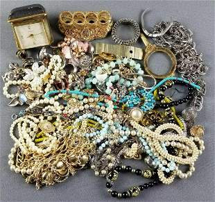 Group of costume jewelry, travel clock, and more