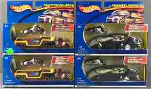 Group of 4 Hot Wheels Pavement Pounder die-cast vehicle
