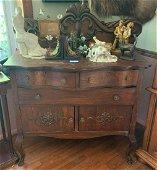 Oak buffet with ornate back