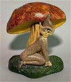 Cast iron Elf and mushroom door stop