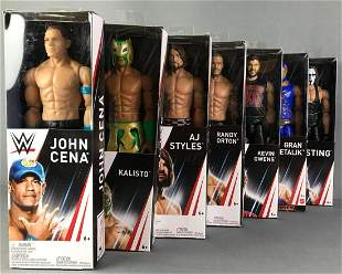 Group of 7 WWE Action Figures