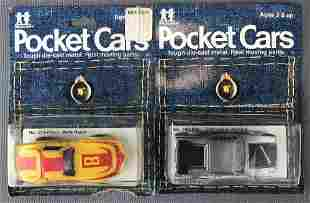 Group of 2 Tomy Pocket Cars