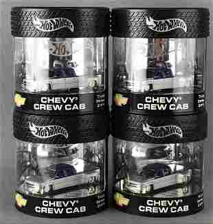 Group of 4 Hot Wheels Chevy Crew Cab die-cast vehicles