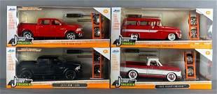Group of 4 Jada Toys Just Trucks die-cast vehicles