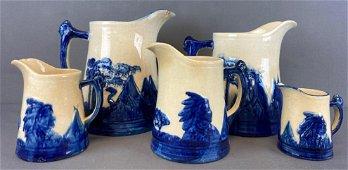 Group of 5 Old Sleepy Eye stoneware pitchers