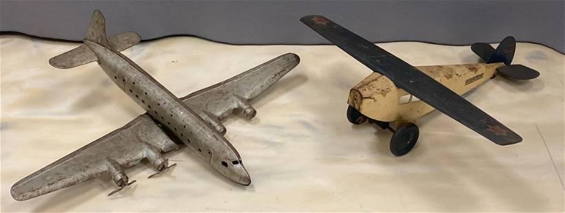 Group of 2 pressed steel toy airplanes