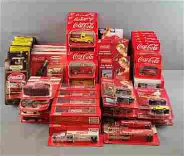 Large group of Coca-Cola die cast vehicles