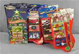 Group of 14 Christmas package die cast vehicles