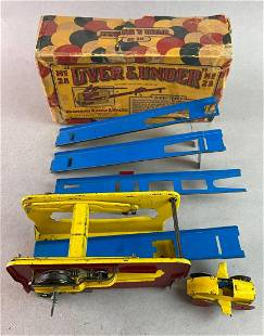 Wolverine Over and Under No28 Wind Up Tin Toy
