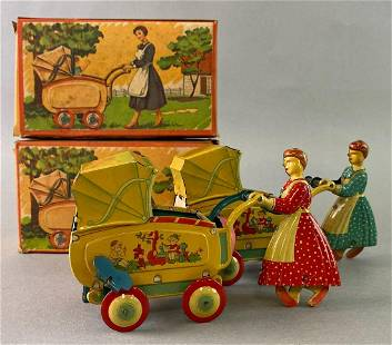 Group of 2 HAJI Baby Carriage Wind Up Tin Toy
