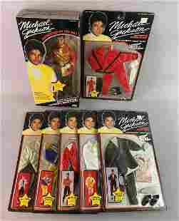 Group of 7 Michael Jackson Doll w Outfirs