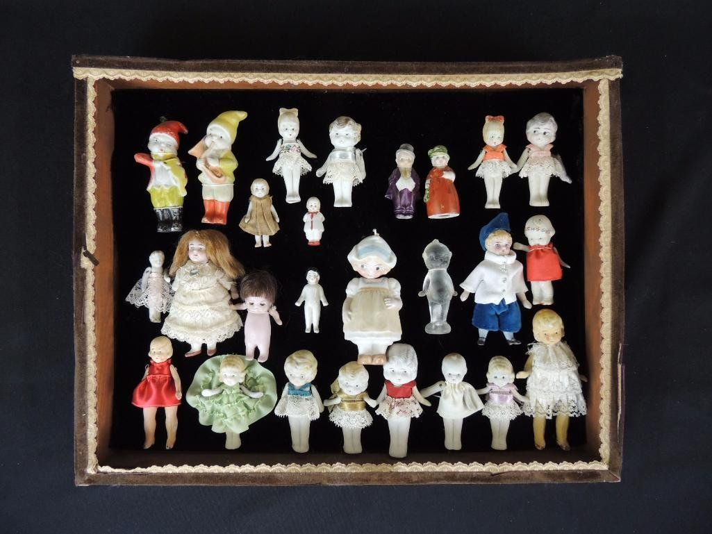 Group of 26 Antique Porcelain Frozen Charlottes in Wood