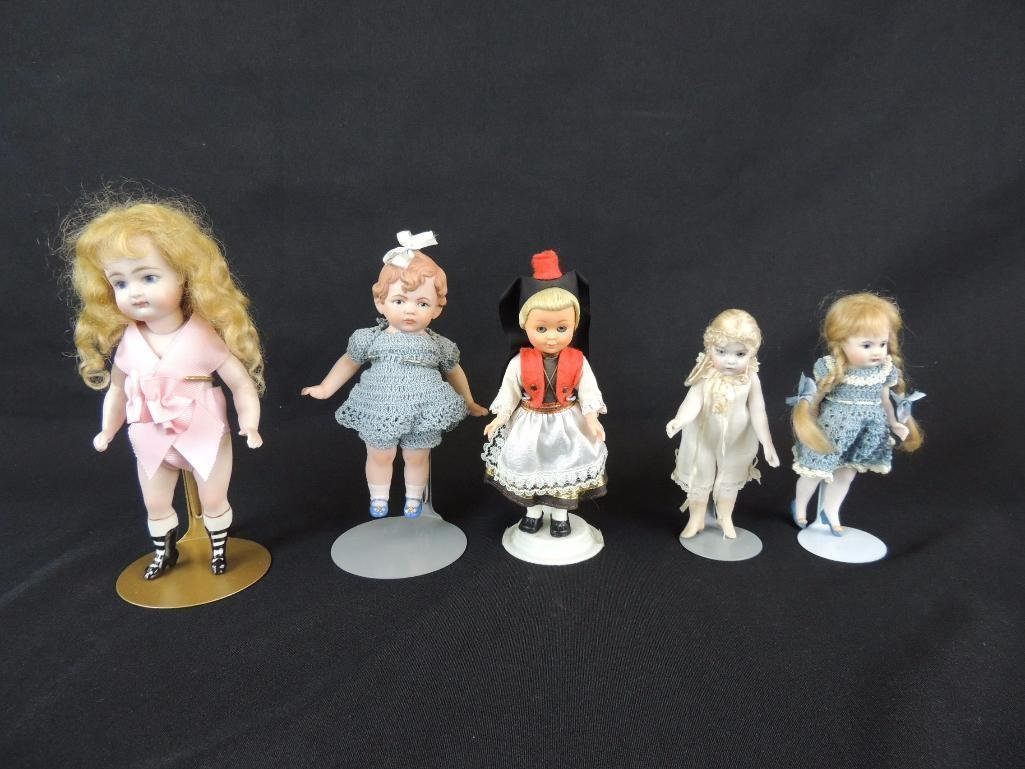Group of 5 Porcelain and Plastic Figurine Dolls