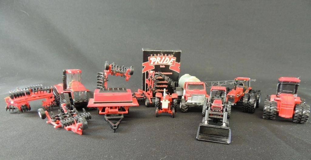 Group of 11Case International Toy Tractors and Plows