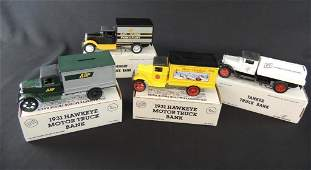 Group of 4 1/34 Scale Die-Cast Coin Bank Trucks