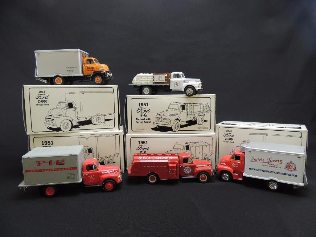 Group of First Gear Ford Trucks Featuring Red Crown,