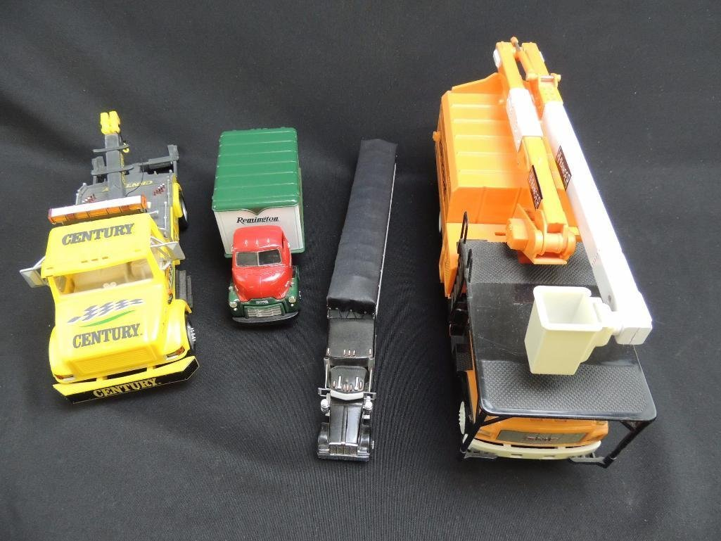 Group of 4 Replica Trucks Featuring Remington, Century, - 2